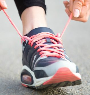 Hands tying running shoes shoelaces