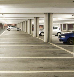 image of car park with three cars in it