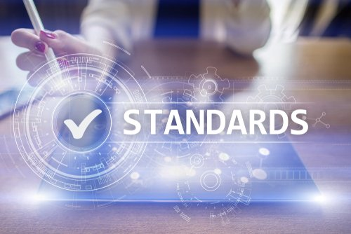 """Desk with """"Standards"""" text imposed above it"""
