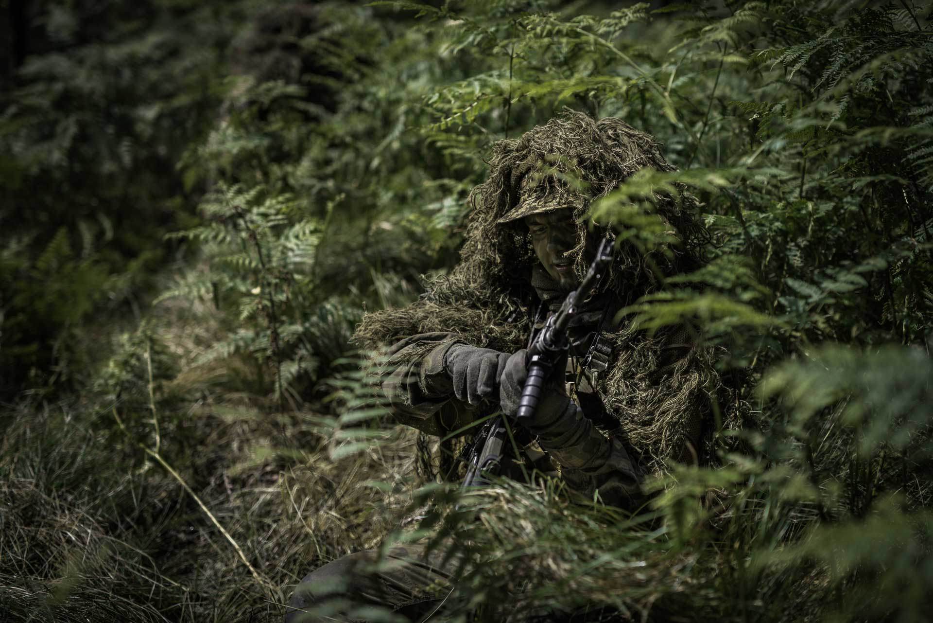 Man in ghillie suit
